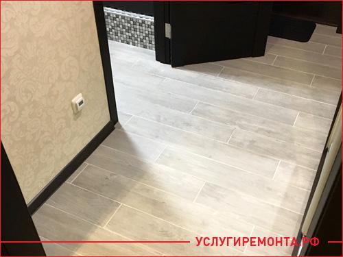 Закончили ремонт новой квартиры, поклали светлый ламинат и темную обналичку на двери