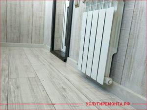 Укладка ламината на балконе и установка батареи отопления